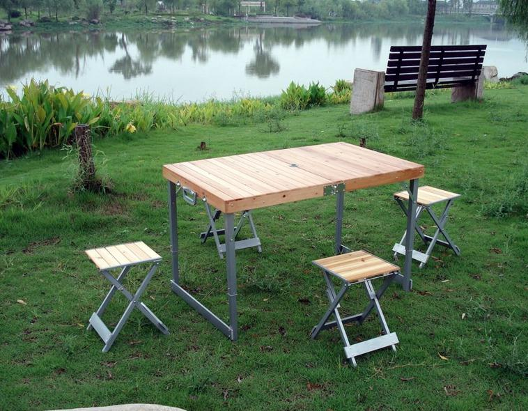 折叠桌椅都有哪些形式与款式,知道的最近流行一种连体式户外折叠桌椅图片