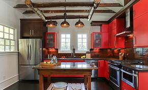 现代工业风橘红色橱柜装修效果图